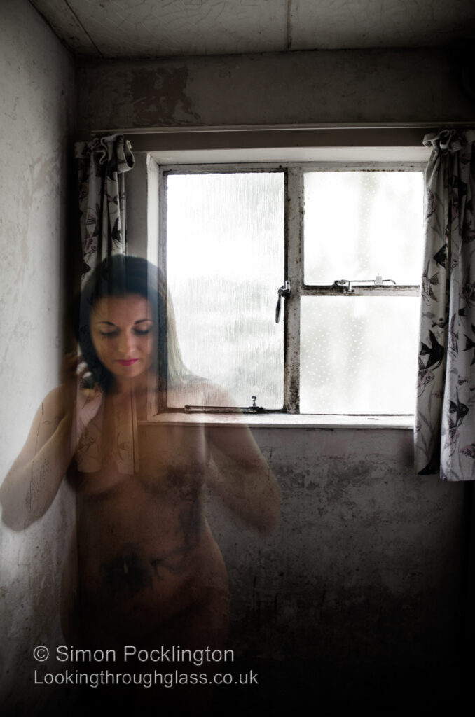 Ghostly nude woman in deserted house
