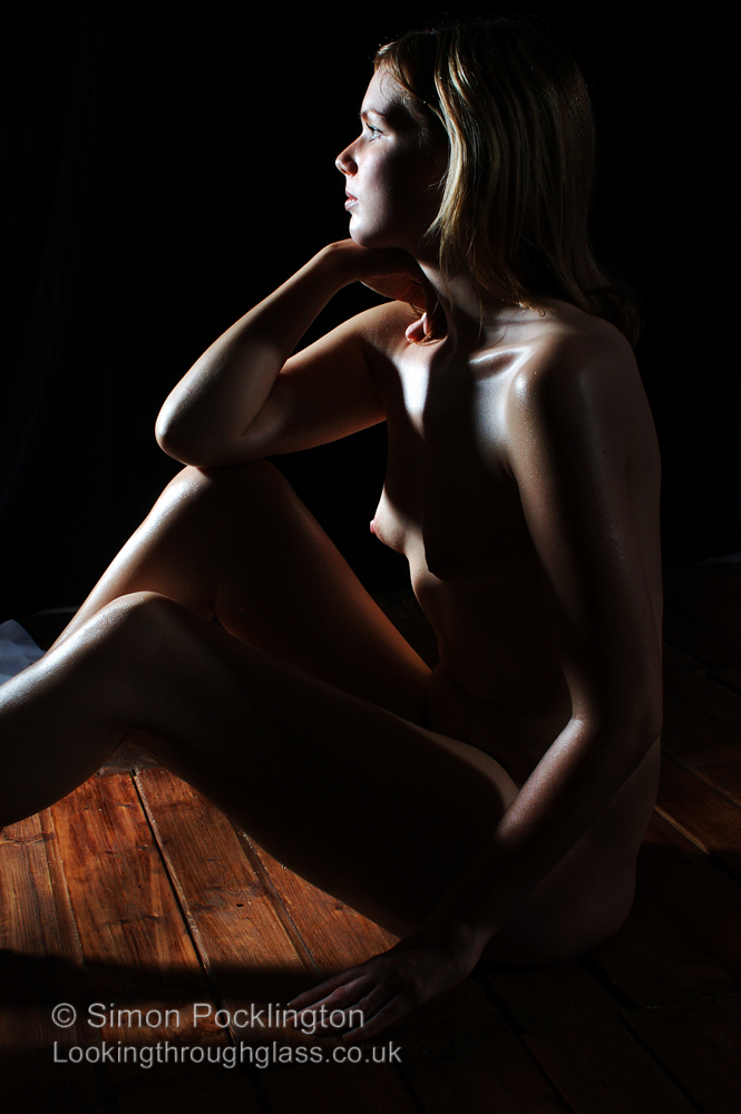 Colour artistic nude portrait photograph of disabled nude model