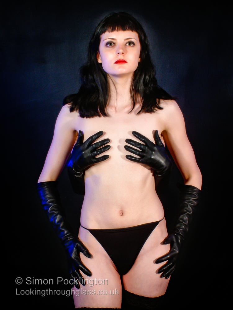 Erotic not nude model ladies in leather gloves