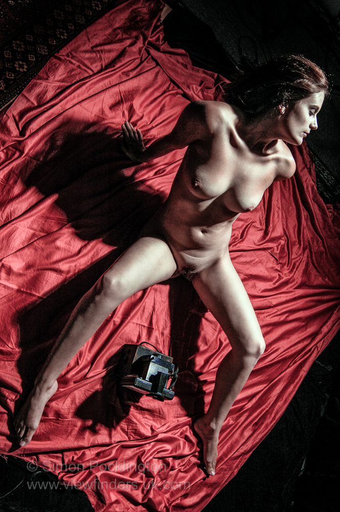 studio nude model with camera